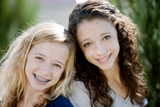 two young girls with braces